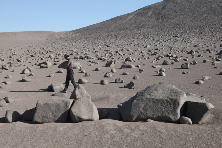 A boulder field in the barren Atacama desert displays evidence of clattering clasts, rubbed smooth by collisions during earthquakes. Photo by Jay Quade, hosted on www.geosociety.org